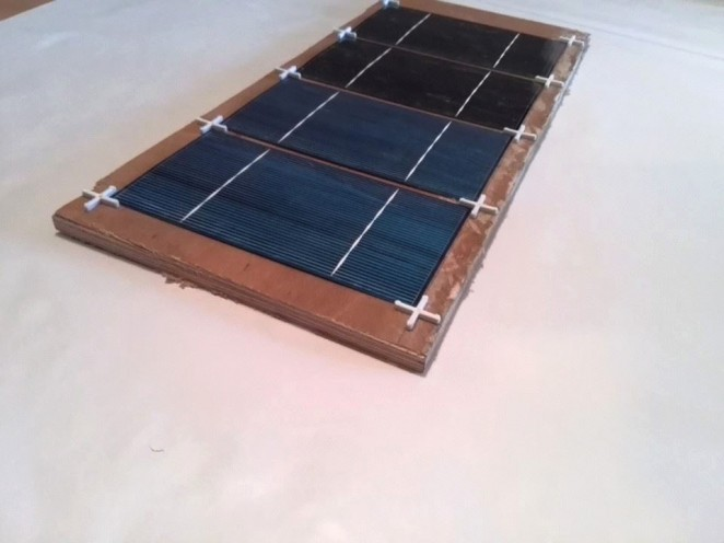Tabbing solar cells using jig made out of tile spacers